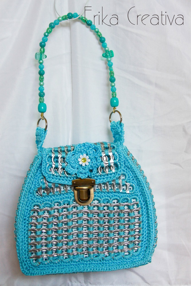 Pop top purse with beaded handle